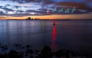 Santa flying over the sea